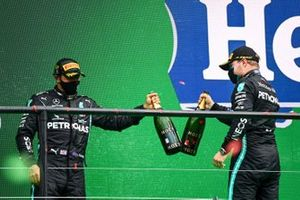 Lewis Hamilton, Mercedes-AMG F1, 1st position, and Valtteri Bottas, Mercedes-AMG F1, 2nd position, celebrate with Champagne on the podium