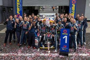 Race winners Shane van Gisbergen and Garth Tander celebrate with team