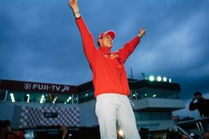 Michael Schumacher celebrates after securing his third F1 title in Japan