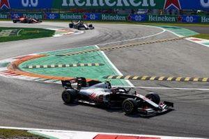 Kevin Magnussen, Haas VF-20, Romain Grosjean, Haas VF-20, and Sebastian Vettel, Ferrari SF1000, on the formation lap