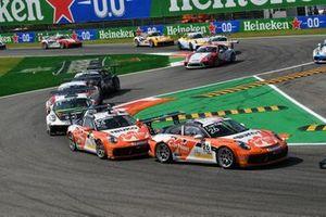 Jesse van Kujik, Team GP Elite, leads Max van Splunteren, Team GP Elite, and Moritz Sager, Dinamic Motorsport, on the opening lap