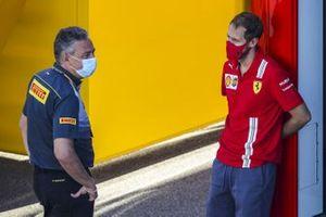 Mario Isola, Racing Manager, Pirelli Motorsport and Sebastian Vettel, Ferrari