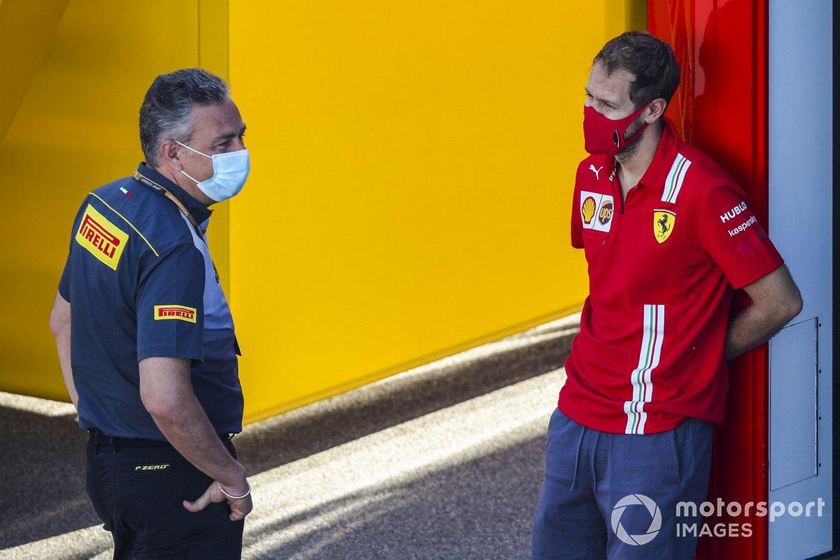 Mario Isola, Racing Manager, Pirelli Motorsport e Sebastian Vettel, Ferrari