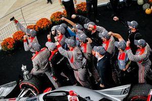 Will Power, Team Penske Chevrolet celebrates winning the Harvest GP Race 2, crew members celebrate