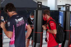 Sebastian Vettel, Ferrari and Lance Stroll, Racing Point
