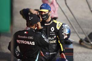 Lewis Hamilton, Mercedes-AMG F1, 1st position, and Daniel Ricciardo, Renault F1, 3rd position, tak in Parc Ferme