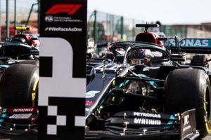 Lewis Hamilton, Mercedes F1 W11, arrives in Parc Ferme after securing pole