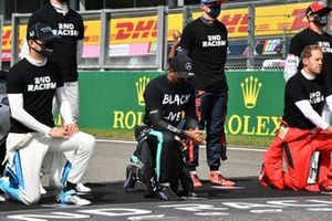 Nicholas Latifi, Williams Racing, Lewis Hamilton, Mercedes-AMG F1, Sebastian Vettel, Ferrari, and the other drivers stand and kneel in support of the End Racism Campaign