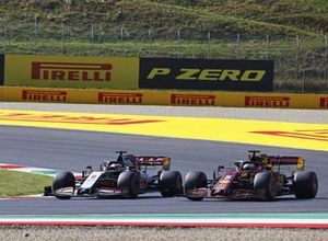 Romain Grosjean, Haas VF-20, battles with Sebastian Vettel, Ferrari SF1000