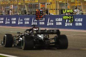 Lewis Hamilton, Mercedes W12, passes a pit board