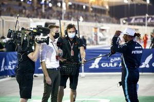 Lewis Hamilton, Mercedes, 1st position, is interviewed by Jenson Button, Sky TV, after the race