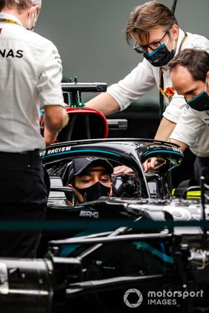George Russell, Mercedes F1 W11, sits in his car