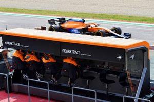Daniel Ricciardo, McLaren MCL35M, passes the McLaren pit wall