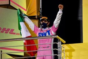 Sergio Perez, Racing Point, 1st position, celebrates with a Mexican flag on the podium