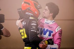 Esteban Ocon, Renault F1, 2nd position, and Lance Stroll, Racing Point, 3rd position, congratulate each other