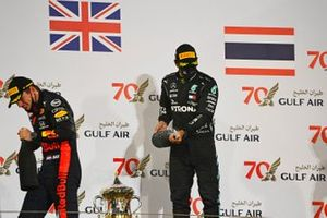 Max Verstappen, Red Bull Racing, 2nd position, and Lewis Hamilton, Mercedes-AMG F1, 1st position, celebrate on the podium