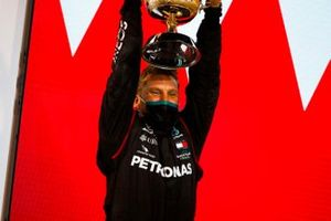 The Mercedes delegate lifts the Constructors trophy on the podium