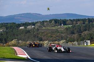 Kimi Raikkonen, Alfa Romeo Racing C39, Max Verstappen, Red Bull Racing RB16, and Carlos Sainz Jr., McLaren MCL35