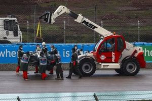 Marshals remove the car of Nicholas Latifi, Williams FW43, from the circuit