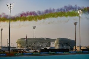 Smoke trail from the fly past prior to the start over the W Yas Hotel
