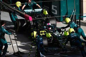 Mechanics push Sebastian Vettel, Aston Martin AMR21, back into the garage