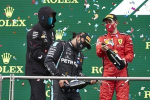 Toto Wolff, Executive Director (Business), Mercedes AMG, Lewis Hamilton, Mercedes-AMG F1, 1st position, and Sebastian Vettel, Ferrari, , 3rd position, celebrate with champagne on the podium