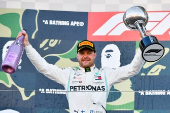 Valtteri Bottas, Mercedes AMG F1, 1st position, on the podium with his trophy and Champagne