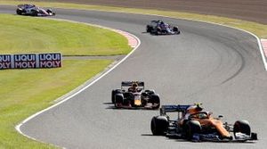 Lando Norris, McLaren MCL34, leads Alex Albon, Red Bull RB15, and Lance Stroll, Racing Point RP19
