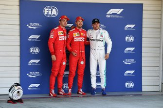 Top three qualifiers Charles Leclerc, Ferrari, pole man Sebastian Vettel, Ferrari, and Valtteri Bottas, Mercedes AMG F1