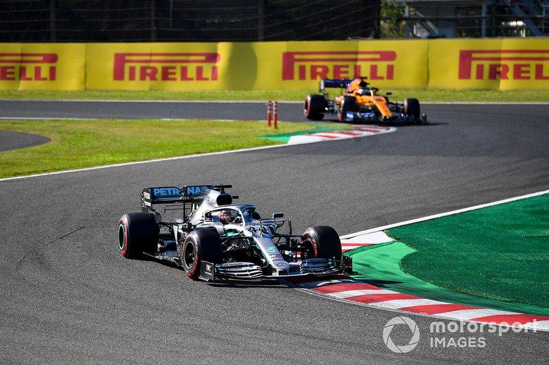 Lewis Hamilton, Mercedes AMG F1 W10, leads Carlos Sainz Jr., McLaren MCL34