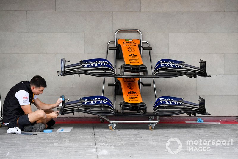 McLaren mechanic with McLaren MCL34 front wing
