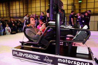 Lando Norris, McLaren on the simulator at the Le Mans eSports Series stand