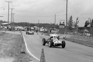 Maurice Trintignant, Cooper T51 Climax, leads Harry Blanchard, Porsche RSK, and Wolfgang von Trips, Ferrari 246