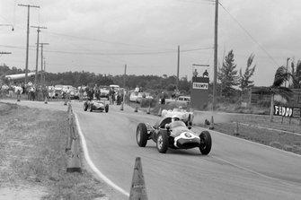 Maurice Trintignant, Cooper T51 Climax, leads Harry Blanchard, Porsche RSK, and Wolfgang von Trips, Ferrari 246