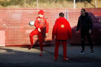 Charles Leclerc, Ferrari, plays football in the paddock