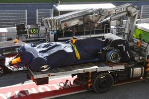 The Max Verstappen Red Bull Racing RB16 is returned to the pits on the back of a truck