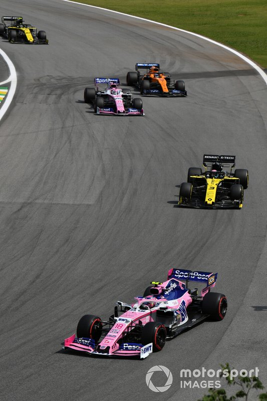 Lance Stroll, Racing Point RP19, leads Daniel Ricciardo, Renault F1 Team R.S.19,Sergio Perez, Racing Point RP19, and Carlos Sainz Jr., McLaren MCL34