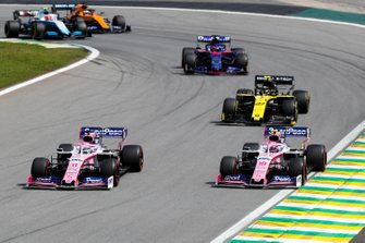 Sergio Perez, Racing Point RP19, leads Lance Stroll, Racing Point RP19, Nico Hulkenberg, Renault F1 Team R.S. 19, and Daniil Kvyat, Toro Rosso STR14