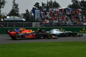 Lewis Hamilton, Mercedes AMG F1 W10, leads Max Verstappen, Red Bull Racing RB15, and Carlos Sainz Jr., McLaren MCL34