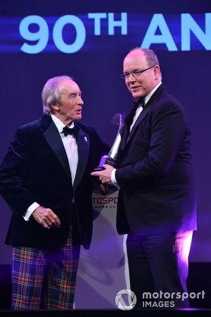 HSH Prince Albert II of Monaco, receives a Gregor Grant Award for the Monaco Grand Prix from Sir Jackie Stewart