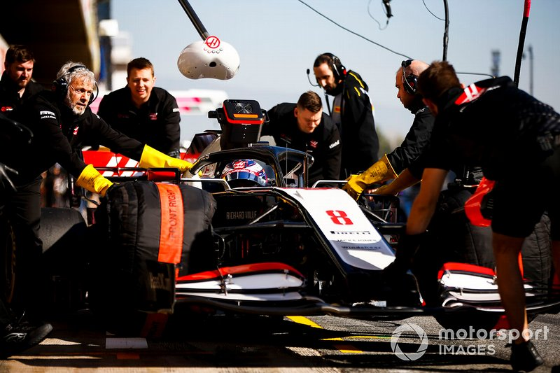 Romain Grosjean, Haas VF-20 being pushed into the garage by mechanics