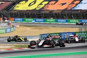 Kevin Magnussen, Haas VF-20, leads Kimi Raikkonen, Alfa Romeo Racing C39, and Esteban Ocon, Renault F1 Team R.S.20