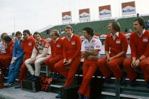 Tyler Alexander, John Watson, and Tony Jardine, among McLaren team members on the pit wall