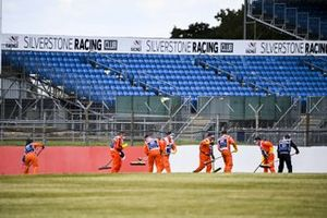 Marshals clean the track after the spin on Nicholas Latifi, Williams FW43