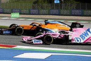 Lando Norris, McLaren MCL35, passes Sergio Perez, Racing Point RP20