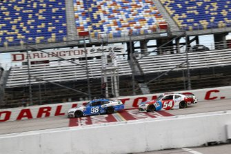 Chase Briscoe, Stewart-Haas Racing Ford leads Kyle Busch, Joe Gibbs Racing Toyota