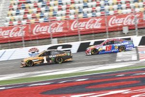 Kurt Busch, Chip Ganassi Racing, Chevrolet Camaro leads Martin Truex Jr., Joe Gibbs Racing, Toyota Camry