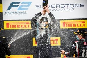 Christian Lundgaard, ART Grand Prix, race Winner Dan Ticktum, Dams and Louis Deletraz, Charouz Racing System celebrate on the podium with the champagne