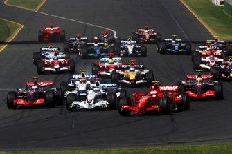 Race winner Kimi Raikkonen, Ferrari F2007 leads at the start of the race