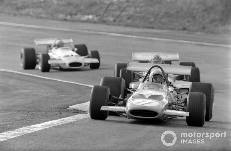Bruce McLaren, McLaren M14A Ford, leads Graham Hill, Lotus 49C Ford, and Rolf Stommelen, Brabham BT33 Ford